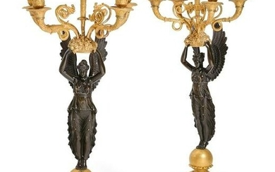 A pair of Empire figural five light candelabra