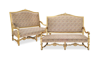 A pair of French late 19th/early 20th century giltwood canapes or sofas