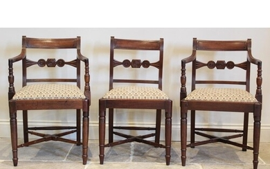 A pair of Regency mahogany carver chairs, each with a concav...