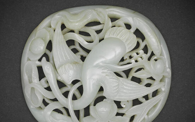 A pale green jade openwork 'Spring Water' oval plaque