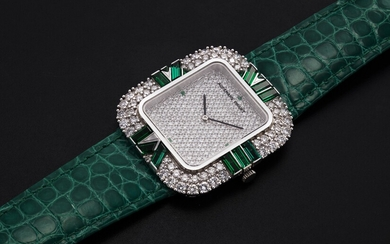 AUDEMARS PIGUET, A LADIES WHITE GOLD WRISTWATCH SET WITH DIAMONDS AND EMERALDS AND A PAVED DIAL