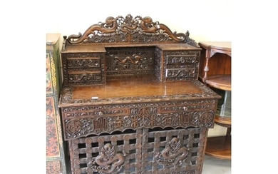 Chinese hardwood writing table, all-over ornately carved wit...