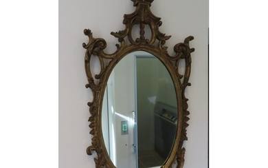 Oval carved gilt wood mirror in 18thC style with replacement...