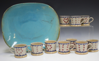 Ten Nicholas Mosse Pottery small mugs, painted with hearts within blue banding, black printed marks
