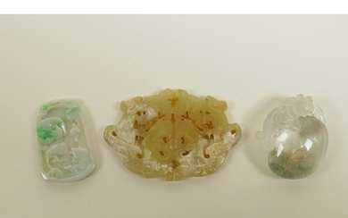 Three Chinese jade and hardstone pendants with carved dragon...