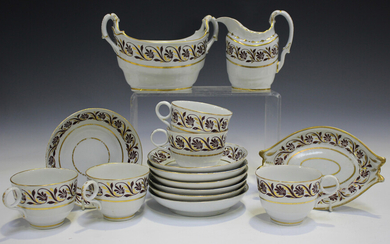 A Barr Worcester part service, circa 1790s, painted with a band of burgundy and gilt foliate scrollw