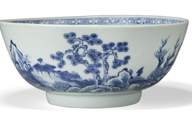 A Chinese porcelain blue and white 'pine tree' bowl excavated from the Nanking Cargo, 18th century, painted with a coastal landscape scene with a lone traveller crossing a bridge amidst pine trees and rockwork, 18.3cm diameter Provenance: Bears...