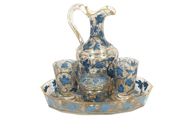 A GILT AND BLUE-PAINTED TRANSPARENT GLASS DRINKING SET MADE FOR THE MIDDLE EASTERN MARKET Possibly France or Bohemia, Czech Republic, early 20th century
