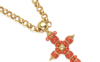 A GOLD AND CORAL CROSS PENDANT ON A GOLD CHAIN