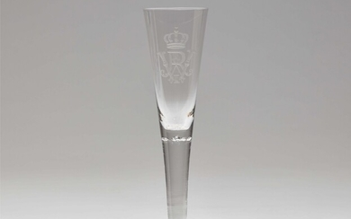 A cut glass champagne flute with the imperial monogram
