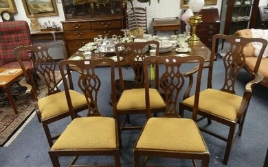 A set of five George III mahogany dining chairs, including t...