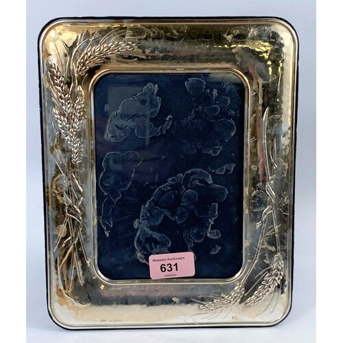 A silver mounted cushion photo frame with wheat straw decora...