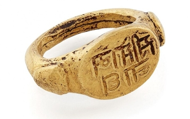 """A very rare early gold ring inscribed """"Sri Somanath"""" (Lord Shiva), South India, 10th-11th century, with raised triangular elements to shoulders, the flat oval bezel inscribed and filled with black substance to enhance the inscription, the band..."""