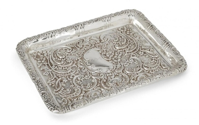 An Edwardian silver tray, Birmingham, c.1902, Thomas Latham & Ernest Morton, of rectangular form, the sides and base richly repousse decorated with scrolls and flowers, the base with monogrammed cartouche to centre, 26.3cm long, 10.9oz