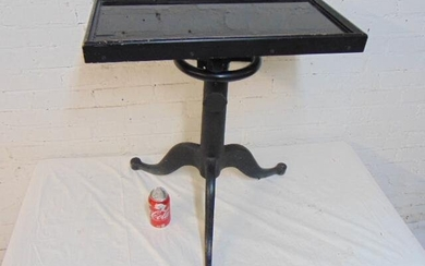 Cast iron base architects table, black glass top in