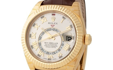 Rolex. Large and Massive Sky-Dweller Automatic Wristwatch in Yellow Gold, Reference 326 138, With Silver Dial