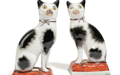 A PAIR OF STAFFORDSHIRE POTTERY MODELS OF CATS