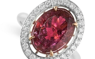 A PINK TOURMALINE AND DIAMOND RING set with an oval cut