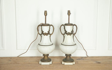 A Pair of French white ceramic and gilt metal mounted lamp bases