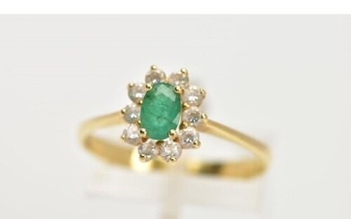 A YELLOW METAL EMERALD AND CUBIC ZIRCONIA CLUSTER RING, cent...