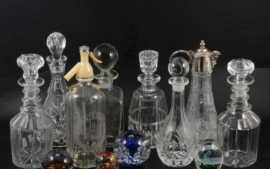 A collection of glassware, including paperweights.