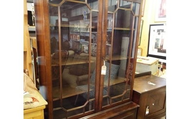 A mahogany glazed bookcase above a double cupboard