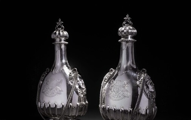 A matched pair of massive Victorian silver pilgrim bottles and covers , one John Bodman Carrington for Carrington & Co., 1892, the other Sebastian Garrard for R. & S. Garrard & Co., 1901, both London
