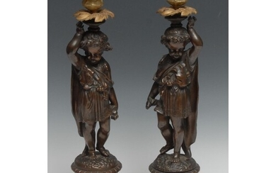 A pair of 19th century French brown-patinated bronze figural...