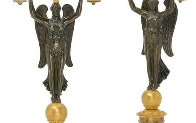 A pair of Empire style bronze figural candelabra