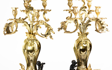 A pair of Empire style gilt mounted five light candelabra