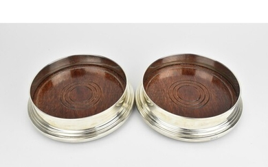 A pair of late 20th century silver wine coasters by A J Pool...