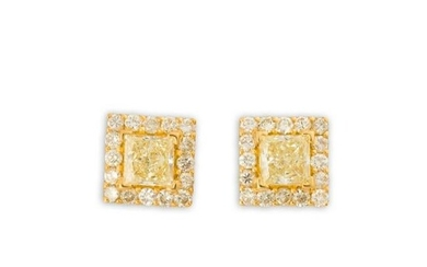 A pair of yellow and near colorless diamond and
