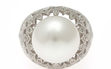NOT SOLD. A pearl and diamond ring set with a cultured pearl encircled by numerous...