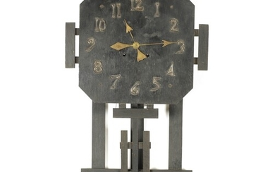 AN AMERICAN ARTS AND CRAFTS WALL CLOCK the ebonised oak case...