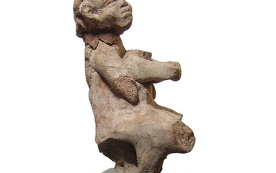 An ancient terracotta figure of a mother with child