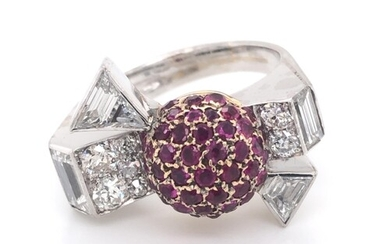 Diamond and ruby cocktail ring in a bow design. Central ball...