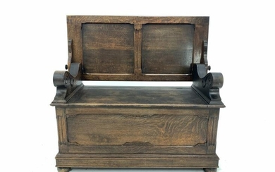Early 20th century oak monks bench, the folding panelled...