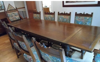 Large 20thC stained oak dining table with drop leaf ends tog...