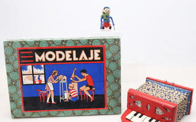 Modelling set, mechanical monkey and toy accordion, circa 1940 and 1960.