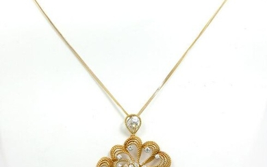 PLATINUM, 18K & 14K DIAMOND PENDANT ON 18K CHAIN