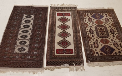 THREE RUGS knotted hands, dominant beige, with geometric decoration one...