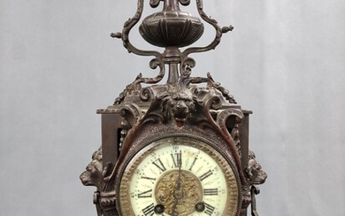 Table clock/fireplace clock, architectural body with vase top, rectangular base, front with two lio