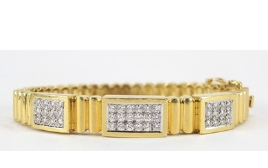 18ct gold diamond cluster hinged bangle, set with forty two ...