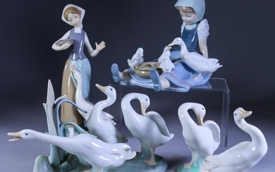A Collection of Thirteen Lladro Porcelain Figures, including -...