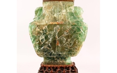 A LARGE AND IMPRESSIVE CHINESE CARVED JADE VASE / LAMP, on a...