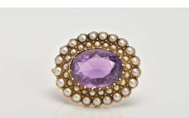 A LATE 19TH EARLY 20TH CENTURY AMETHYST AND SEED PEARL BROOC...