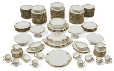 A Limoges porcelain (Theodore Haviland) part dinner service, 20th century, with gilt decoration, comprising; twelve coffee cups and eleven saucers, twelve teacups and eleven saucers, two sauce boats with fixed stands, two large oval dishes, one...