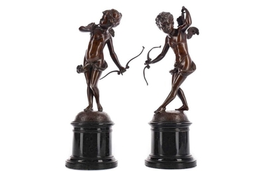 A PAIR OF LATE 19TH CENTURY BRONZE FIGURES OF CUPID WITH A BOW