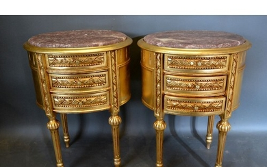 A Pair of French Gilded Oval Chests, the variegated marble t...