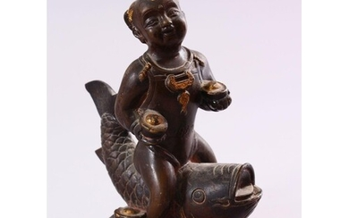 A SMALL CHINESE BRONZE FIGURE OF A BOY SEATED UPON A CARP, 1...